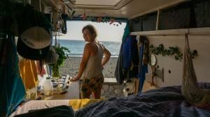 Portrait of Lucia standing in her Van
